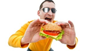 Man eating hamburger on white background